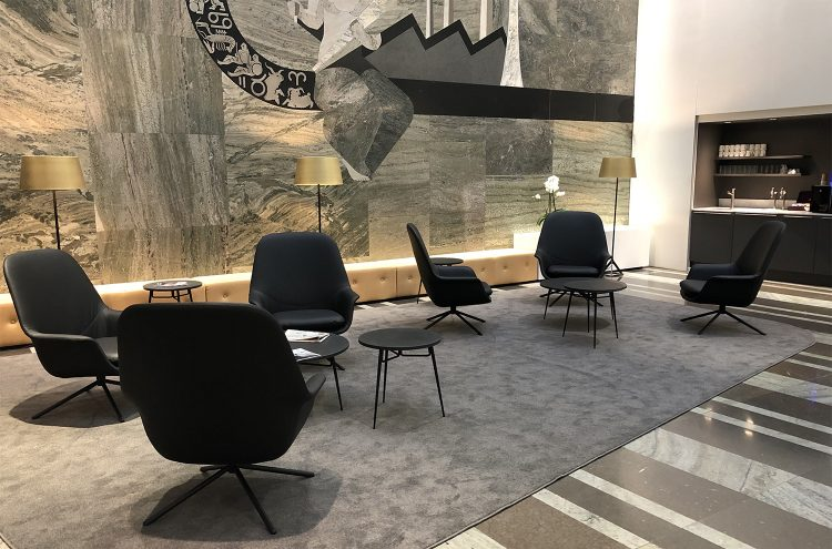 Two groups of Icons of Denmark smile lounge chairs with spire tables in Danske Bank HQ, Stockholm.