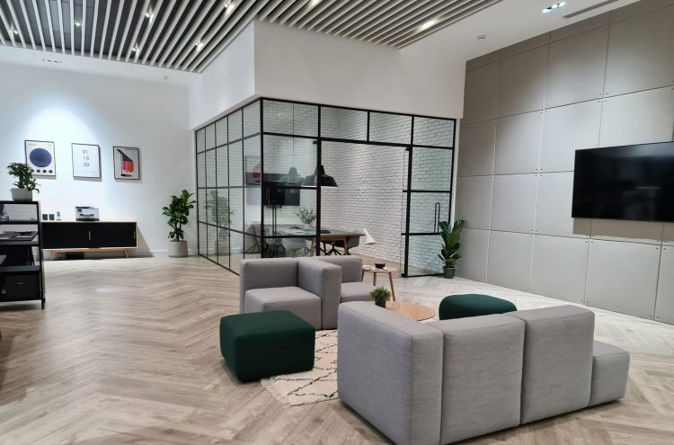 OTDS Project EC1 Sofa with Knock on Wood coffee tables within main reception and looking into boardroom with chairs and table